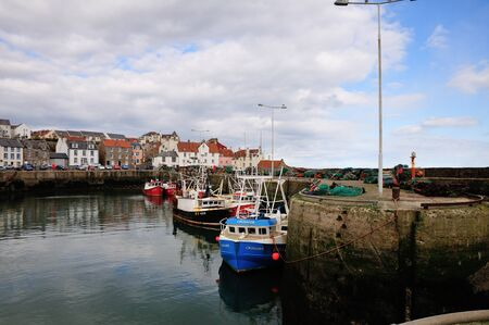 tiedup: Fishing boats in a Harbour.