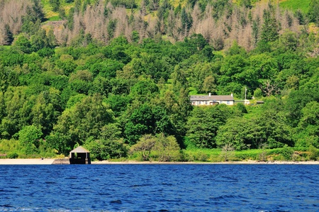 sir walter scott: Secluded boathouse on a Scottish Loch  Stock Photo
