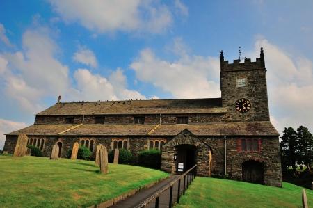 Old village church and gravestones Stock Photo - 21409447