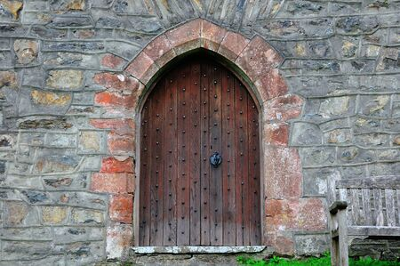 Arched doorway into church  photo