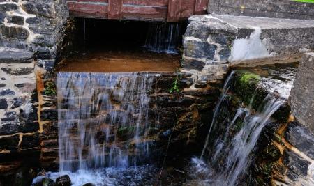 sluice: Sluice at a Water Mill  Stock Photo