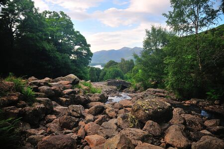 Old stone bridge with Derwent Water in the background Stock Photo - 21657197