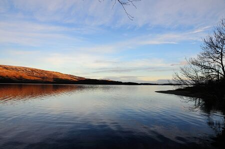 loch lomond: Taken from the West shore of Loch Lomond, looking south in the evening sun. Stock Photo
