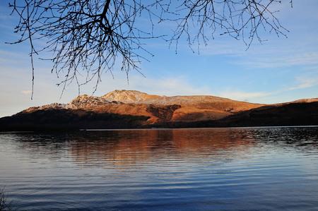 loch lomond: Ben Lomond taken from the West shore of Loch Lomond in the evening sun. Stock Photo