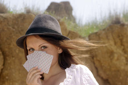 Country-gril with cards in a hat