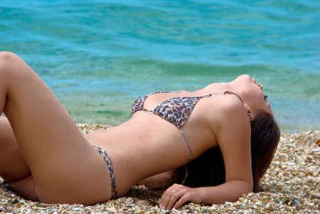 Beach girl near the water
