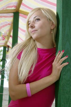 Blonde under beach tent smiling