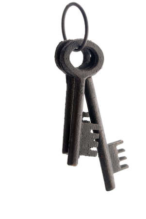 Three old fashinoed keys on a ring isolated. Red highlight photo