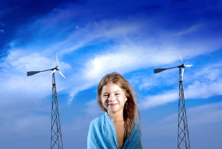 young lady with windgenearators on the blue sky photo