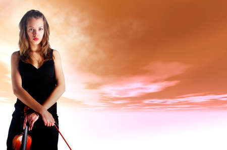 lady violinist and sky Stock Photo