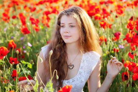 girl on a red poppy field
