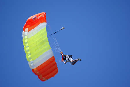 man on paraglider in the sky