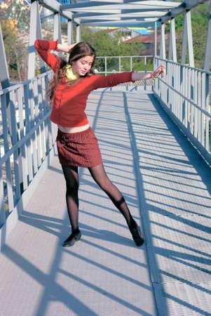 school uniform girl: school girl on an iron bridge