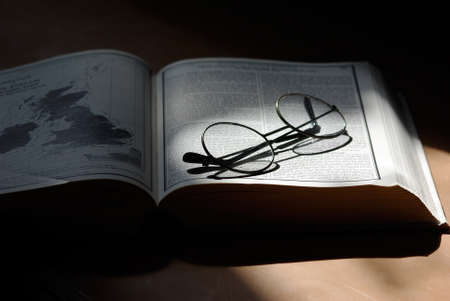 open meteorology book with vintage round glasses