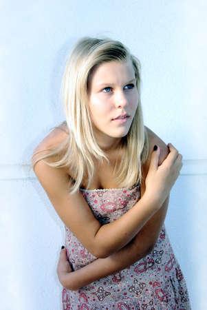 teen girl model shot near wall photo