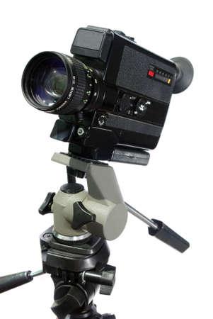 vintage super-8 movie camera on tripod head over white