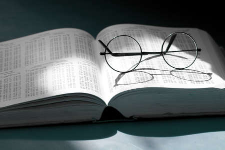 open  book with vintage round glasses