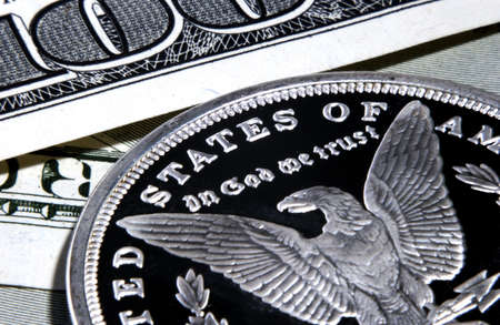 silver eagle in god we trust coin and bills   Stock Photo