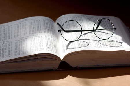 round glasses in a book Stock Photo