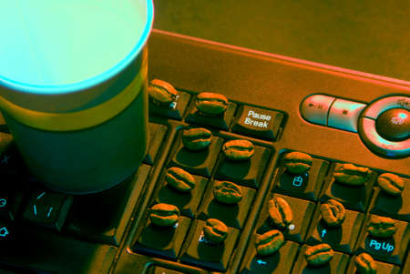 Coffee break (pause) keyboard with coffee beans paper cup and pause key