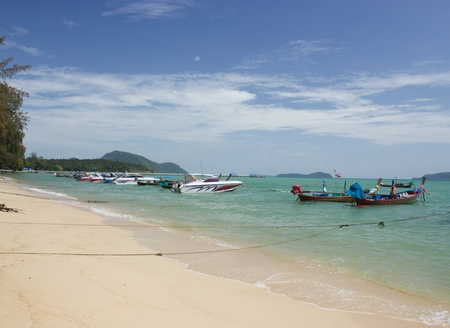 Boats moored at the beach photo