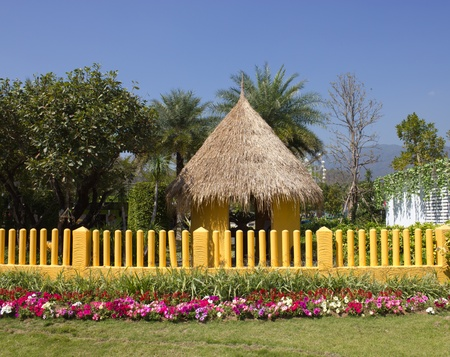 Yellow fence and flower garden Stock Photo - 12523624