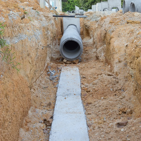 Concrete drainage tank on construction site Stock Photo
