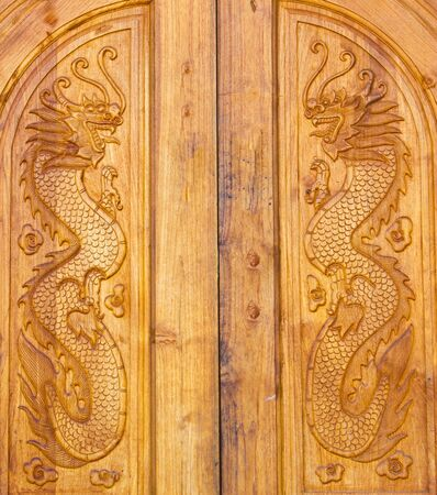 Dragon wood door texture at Chinese village photo