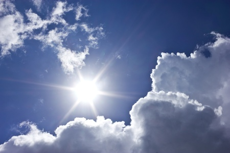 Sunbeam with blue sky and clouds