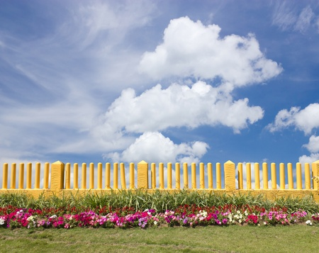 Yellow fence and flower garden Stock Photo - 13413030