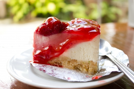 Strawberry cheese cake on wood in coffee shop photo