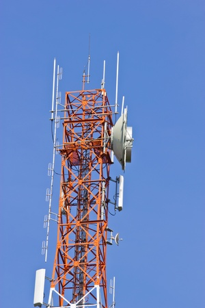 Communication tower on blue sky photo