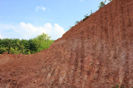 Soil on the slope of the road photo