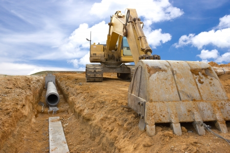 Digging drains to prevent flooding Stock Photo
