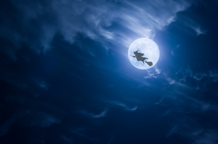witch on broom: Witch flying past the moon