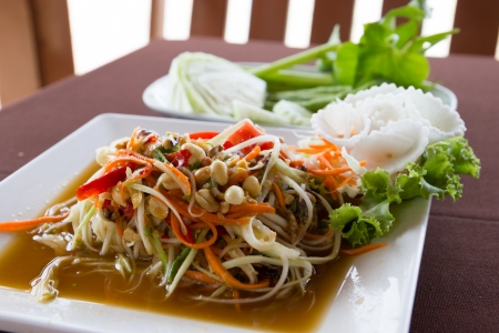 Papaya salad with crab on table photo