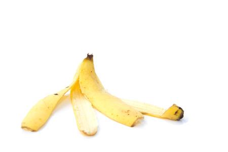 バナナの皮をむくに孤立した白い背景