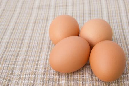 Eggs on tablecloth photo