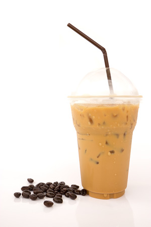 Iced coffee with coffee beans isolated on white background photo