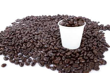 Coffee beans with paper cup photo
