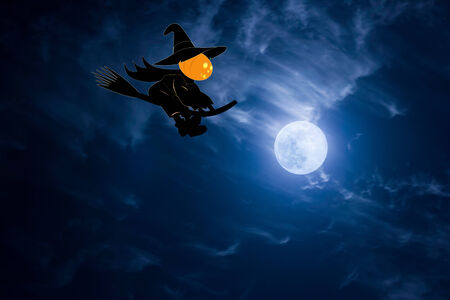 Pumpkin is a witch on halloween night photo