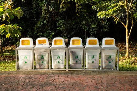 segregate: Trash cans in the park beside the walk way Stock Photo