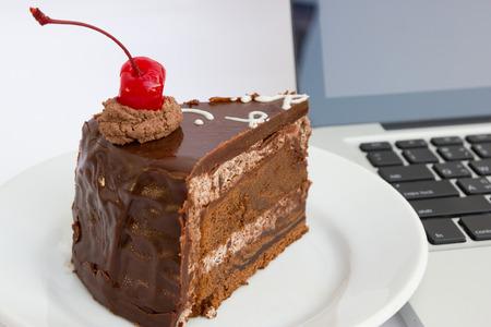 Chocholate cake and laptop photo