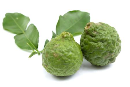 Bergamot and bergamot leaves isolated on white background photo