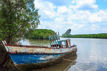 Old wooden boat in Krabi, Thailand photo