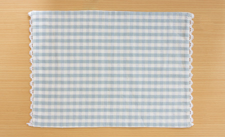 Tablecloth on wooden table photo