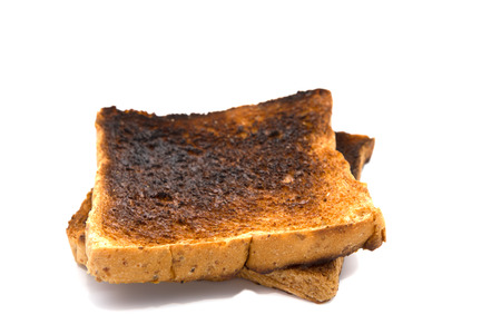 Burnt toast slice isolated on white background Standard-Bild