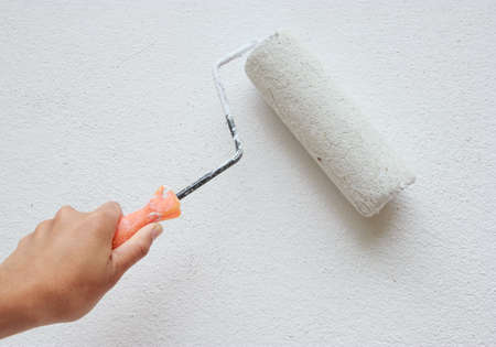 Painting wall in white photo