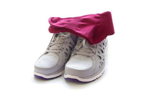 Sport shoes and socks isolated on white background photo