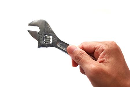 Hand holding wrench isolated on white background photo